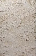 Эффект камня создается благодаря использованию штукатурной смеси с включением крупнофракционных добавок.