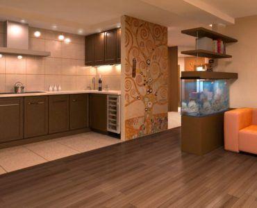 Разграничение пространства кухни и гостиной с помощью фальшстены и аквариума.
