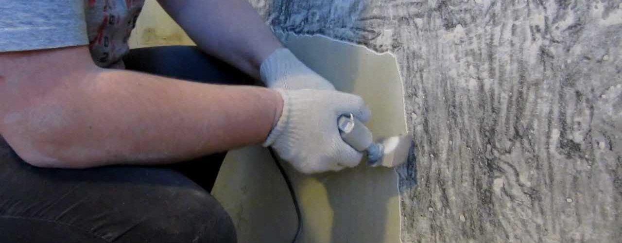 Удаление шпаклевки со стен