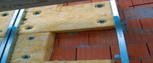 Крепление минеральной ваты на кирпичной стене